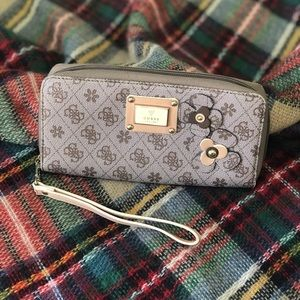 Authentic Guess zip wallet with wrist strap